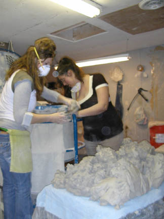 mixing clay carmen and alissa.jpg