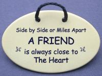 Side by Side or Miles Apart A FRIEND is always close to the Heart
